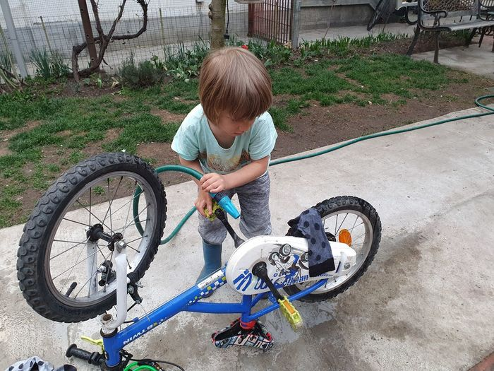 High angle view of boy riding bicycle