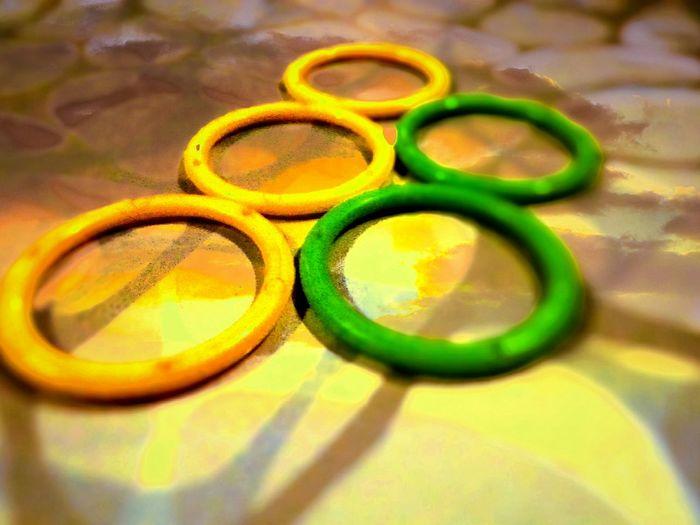 The Color Of Sport We All Unitee Olympics Logo Burning Background Symbolizong The Light