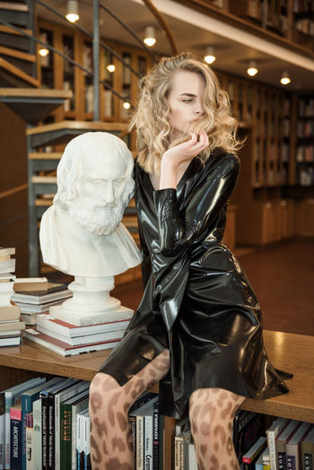 Smooth Confess Black Dress Latex Dress  Fashion Sculpture Library Model Curly Hair Books Pretty Face  Woman Make Up Glamour Linas Was Here The Modern Professional