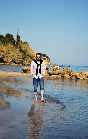 Beach Casual Clothing Clear Sky Lifestyles Man Nature Ocean View Sea Sea And Sky Walking Walking Alone... Walking By The Beach Walking By The Sea Water Young Adult Original Experiences Live For The Story Fashion Stories