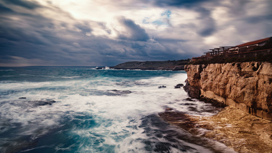Capo Santa Croce, not quiet sea Power In Nature Sea Sky Cloud - Sky Water Beauty In Nature Horizon Wave Outdoors Rock Nature Rough Sea Scenics - Nature Photography Photo Amazing Power Beauty In Nature Horizon Over Water High Angle View Blue