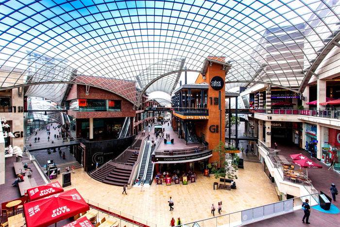 Interior of Cabot Circus shopping centre in Bristol Adult Architecture Bristol Built Structure Cabot Circus Carousel City Commerce Day Glass Roof Indoors  Large Group Of People Lifestyles Modern Panoramic People Real People Restaurants Retail  Shop Till You Drop Shopping EyeEmNewHere