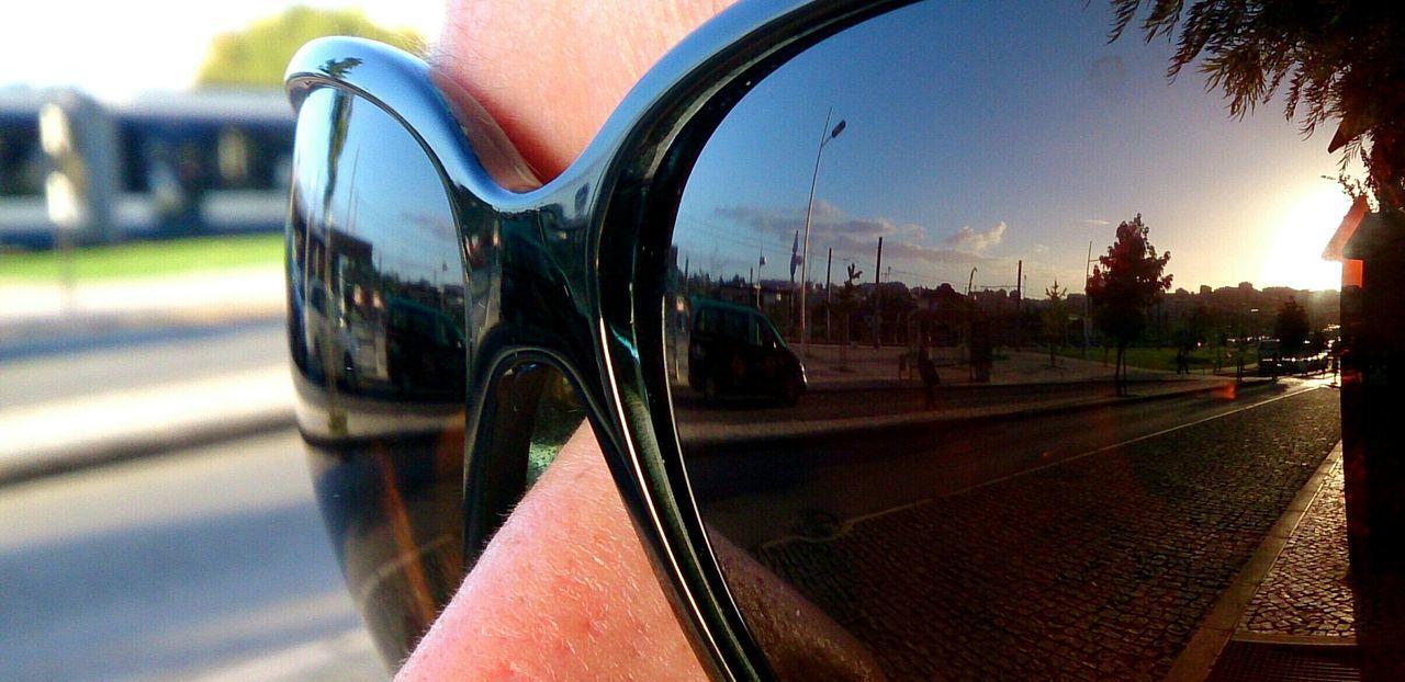 Close-up of woman wearing sunglasses