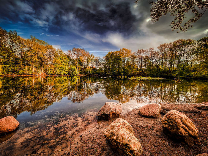 Reflection of trees in lake against sky during autumn