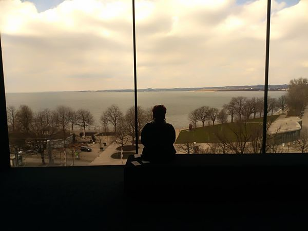 The world behind her No Filter, No Edit, Just Photography Approaching From Another View Shadows & Lights Meditation Place Lake View One Woman Only Architecture Silence Horizon Over Water Looking Through Window Waterfront