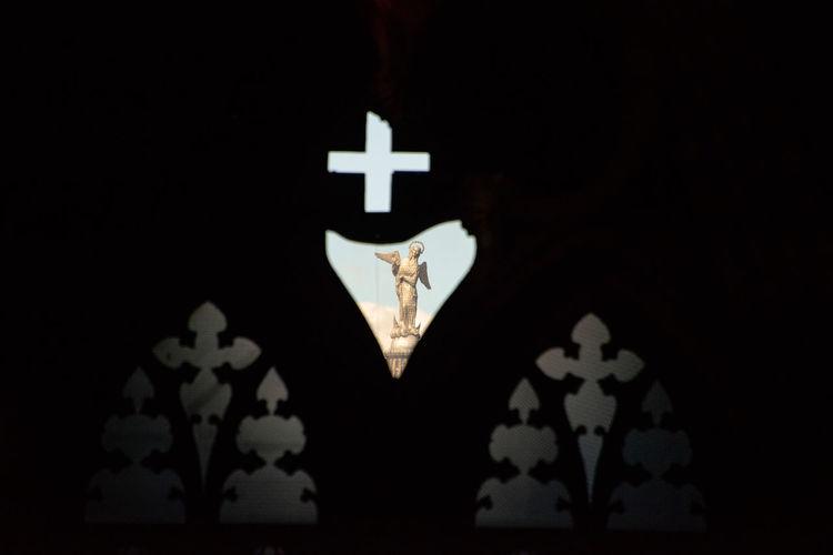 Close-up of illuminated lighting equipment in darkroom