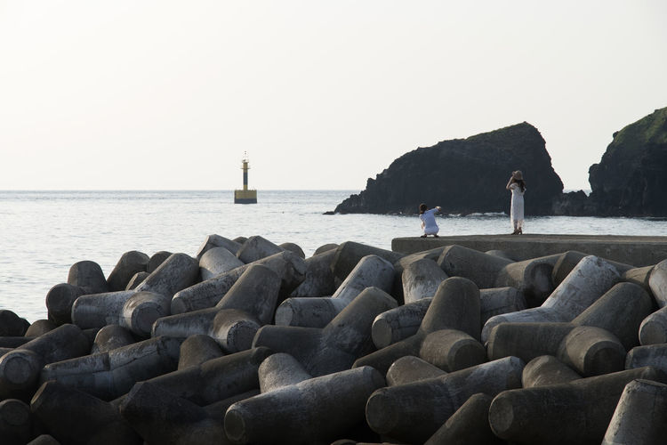 seaside view of Chagwido in Jeju Island, South Korea Beach Beauty In Nature Chagwido Clear Sky Day Groyne Horizon Over Water JEJU ISLAND  Lighthouse Men Nature Nautical Vessel One Person Outdoors People Real People Rock - Object Sea Seaside Sky Water