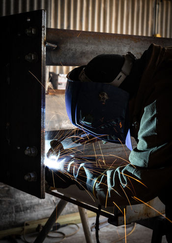 Industry Clothing Indoors  Jeans Men Metal Obscured Face Occupation One Person Protection Real People Technology Unrecognizable Person Welding Working