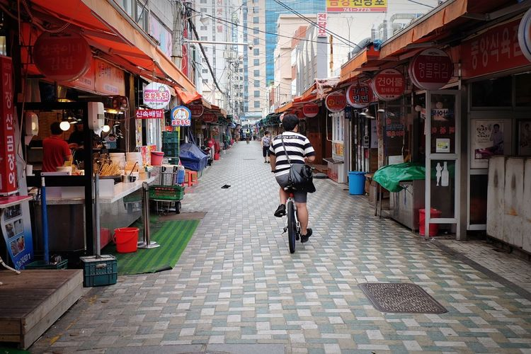 street culture Bicycle Cycling City Riding Adult Day Outdoors One Person People Korea Culture Busan City Life City Bikelife Culture Of Korea Culture And Tradition Marketplace Market Pedestrian Travel Busan,Korea
