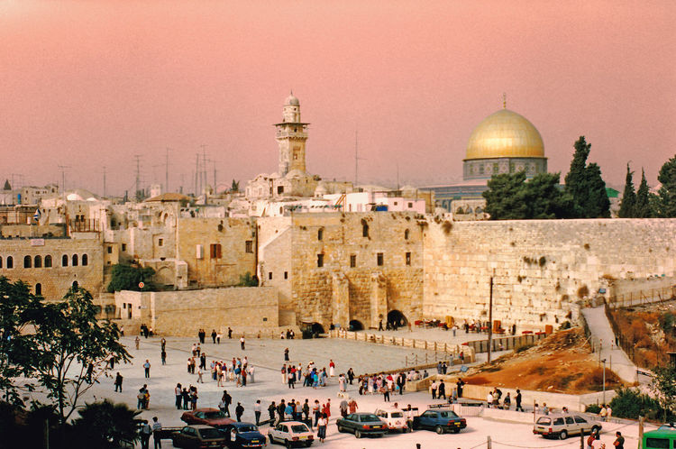 """General view of the Western Wall area with the Dome of the Rock mosque behind - Jerusalem, Israel The Western Wall, or """"Wailing Wall"""", is the most religious site in the world for the Jewish people. Located in the Old City of Jerusalem, it is the western support wall of the Temple Mount. Thousands of people journey to the wall every year to visit and recite prayers. These prayers are either spoken or written down and placed in the cracks of the wall. The wall is divided into two sections, one area for males and the other for females. It is one of the major highlights in any tour of the Old City. Architecture Nature Real People Men Women Tree Spirituality Travel Tourism Day History Outdoors Ancient Religion Clear Sky Dome Lifestyles Place Of Worship Wailing Wall Temple Mount Travel Destinations Ancient Civilization Large Group Of People Leisure Activity Building Exterior Built Structure Old Ruin Western Wall Of Jerusalem Dome Of The Rock Jerusalem Jewish Peoples An Eye For Travel Colour Your Horizn Stories From The City Adventures In The City The Street Photographer - 2018 EyeEm Awards The Traveler - 2018 EyeEm Awards"""