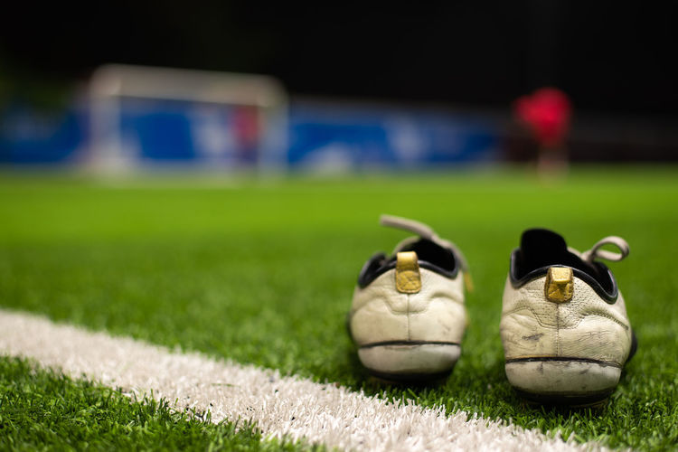 Sport Grass Soccer Team Sport Sports Equipment Competition Plant Ball No People Shoe Soccer Ball Focus On Foreground Pair Playing Field Stadium Nature Competitive Sport Soccer Field Outdoors Soccer Team  Soccer Boots Field