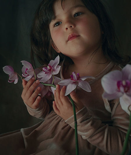 Close-up of cute girl with pink flowers