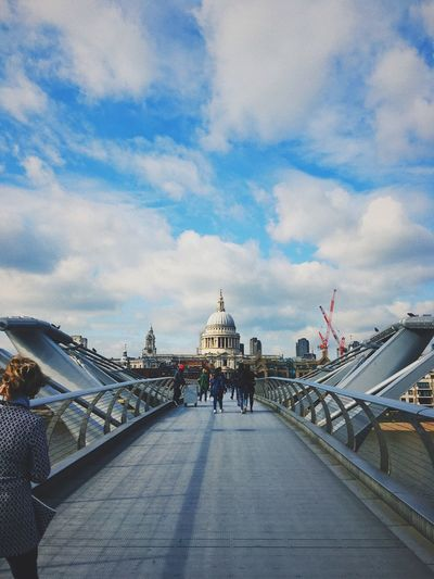 People Walking On Millennium Bridge Against Cloudy Sky