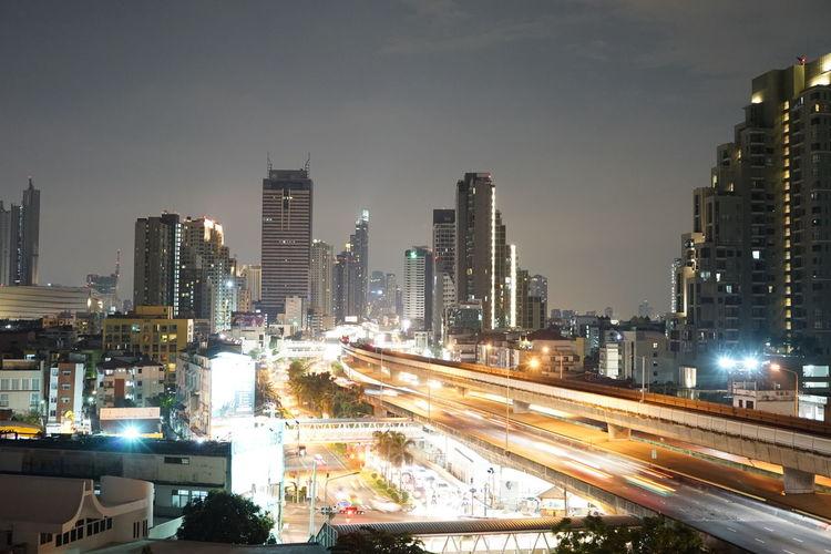 Bangkok metropolis long expose Night Bangkok Thailand. Bankkok Bankkok To Night Cars Red Road Bridge Building Exterior Expressway Hightway Long Exposure Orange Color Trail Lights Train