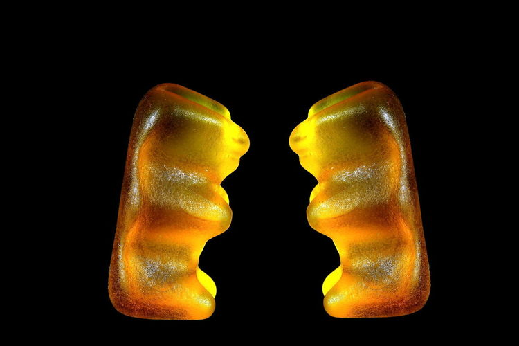 Vis-a-vis Oppsite Black Background Studio Shot Two Objects Food Jelly-babies Still Life