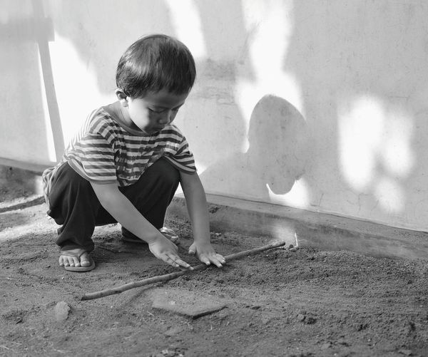 Toddler Playing By Wall