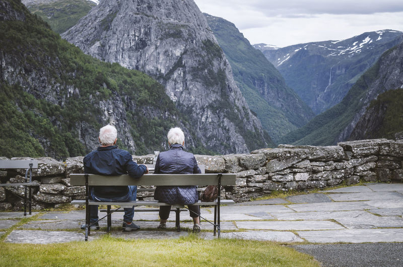 Two senior adults sitting on a bench Nature Norway Stalheim Hotel Travel Wanderlust Beauty In Nature Casual Clothing Day Explore Full Length Lake Landscape Leisure Activity Lifestyles Men Mountain Nature Outdoors Pension Real People Rear View Relaxation Scenics Senior Adult Senior Couple Senior Men Senior Women Sitting Stalheim Stalheimsklevia Togetherness Tranquil Scene Tranquility Two People Women Summer Exploratorium Adventures In The City The Great Outdoors - 2018 EyeEm Awards The Traveler - 2018 EyeEm Awards