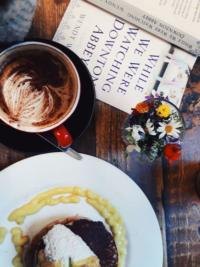 Breakfast Reading Book Coffee Coffee - Drink Coffee Cup Cup Drink Flower Food Food And Drink Freshness High Angle View Indoors  Mug No People Pancake Pancakes Plate Ready-to-eat Refreshment Still Life Sweet Food Table