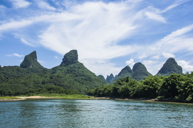 The beautiful karst mountains and Lijiang River scenery Attraction Blue Clear Water Countryside Destination Idyllic Journey Ka Karst Landscape Light And Shadow Mountain Mountain Background Nature River Rural Scene Scenery Scenic Sightseeing Summertime Travel Destinations Unique Water Wonderland Yangshuo