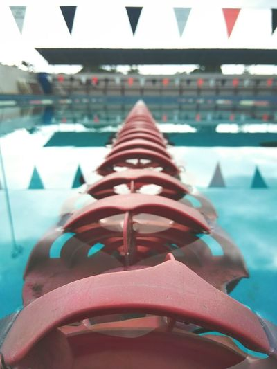 Close-up of shoes on swimming pool in city