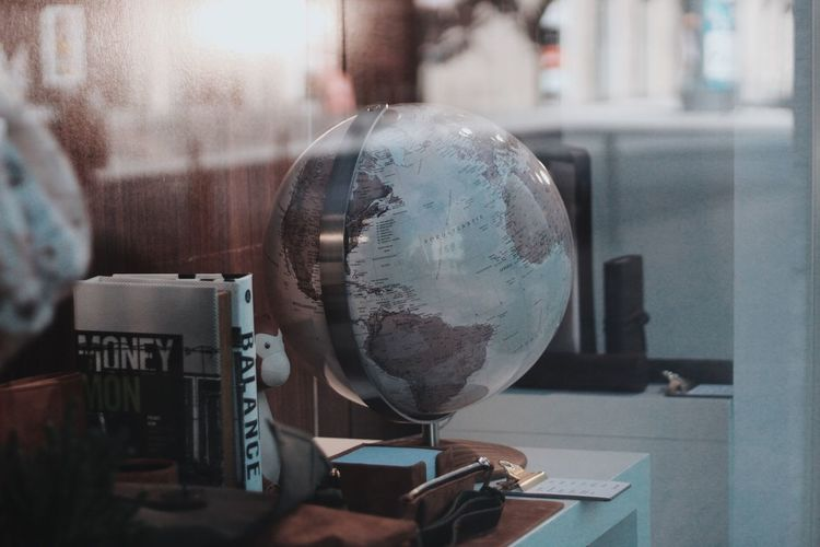 Close-up of globe on table in office