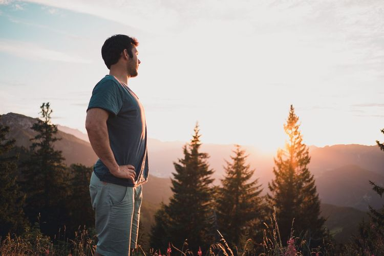 Enjoying the sunset Mountain Nature Live Authentic Casual Clothing Real People Three Quarter Length Standing One Person Lifestyles Nature Sky Tree Growth Leisure Activity Young Men Sunset Beauty In Nature Landscape Day Young Adult Outdoors Plant Mountain