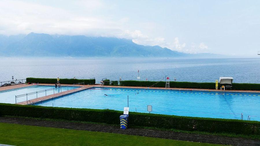 Swimming Pool By Seaside Against Sky