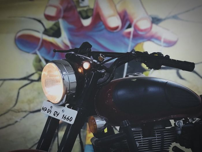 The hand of today's youth who love the royal Enfield Camera - Photographic Equipment Photography Themes Photographing Communication Focus On Foreground Close-up Day Digital Single-lens Reflex Camera Indoors  No People