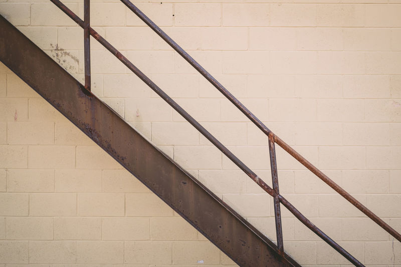 Close-up of staircase against wall
