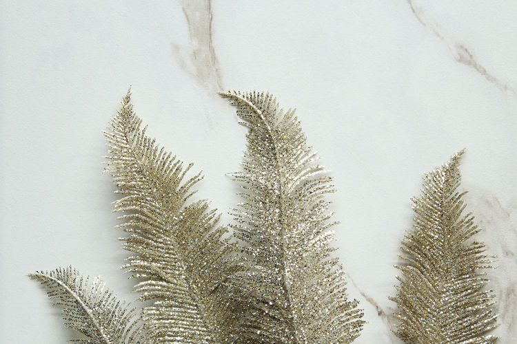 Close-Up Of Christmas Decoration On Marble
