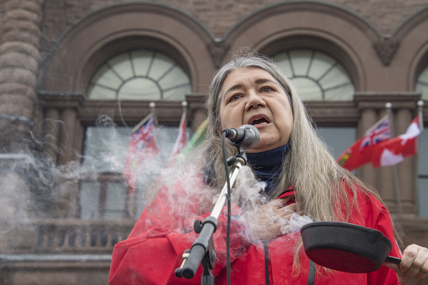 Women's Solidarity March in Toronto, Canada. January 21, 2017 marked the history of the capital city of Ontario with one of the largest protest march gathering more than 60,000 people. Women were claiming more social justice and protesting many of Donald Trump stances. Anti-trump Canada Canadian Demanding  Democracy First Nations Freedom Girls Leader Leftist March Movement Ontario Outdoors People Power Revolution Signs Social Justice Speaker Symbols Toronto Toronto Canada Women's March Women's Solidarity March