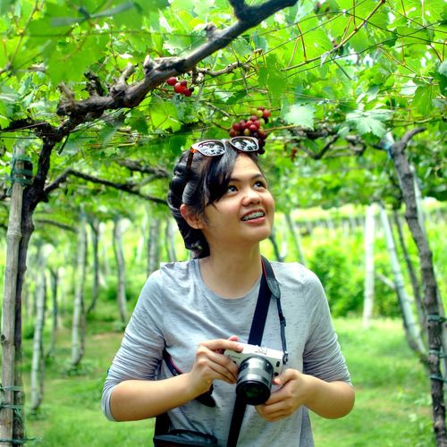 wondering Candid Cheerful Happiness Outdoors Nature Women Day Young Women Young Adult One Young Woman Only People Smiling Tree Grapes Grapevines  Grapevine