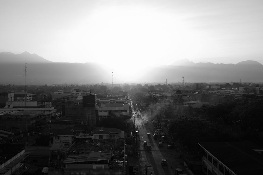 outtake from my photo essay on Oslob, Cebu published on September's LE Mag http://bit.ly/2bD60O7 B&w Street Photography Black And White City Cityscape Dramatic Sky Dumaguete Fujifilm_xseries Getting Inspired High Angle View Horizon Over Land Moody Mountain Range Mountains No People Philippines Sunbeam Sunset Travel Destinations Urban Urban Landscape Urban Lifestyle
