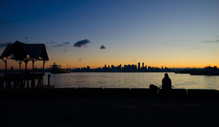 Cityscape Silhouette Skyline Architecture Beauty In Nature Blue Sky Building Exterior Built Structure City Nature Night Outdoors Scenics Sea Silhouette Sky Stars Sunset Water