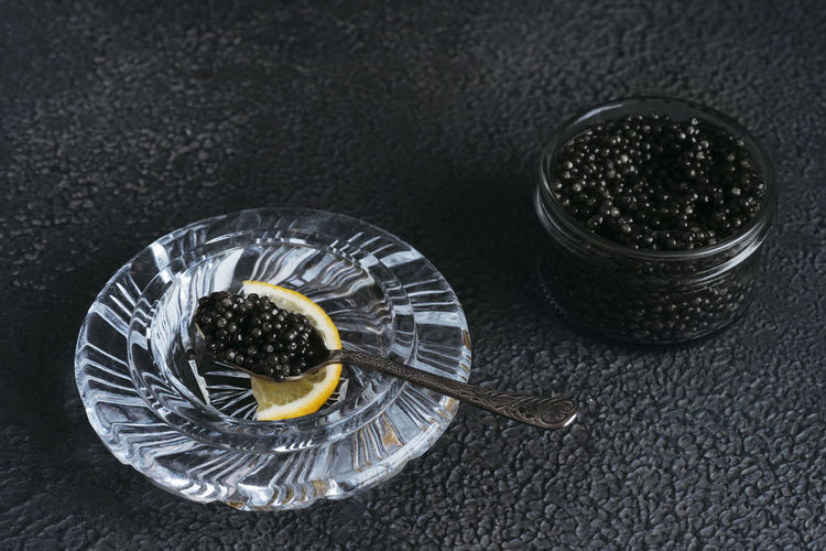 High angle view of drink in glass against black background