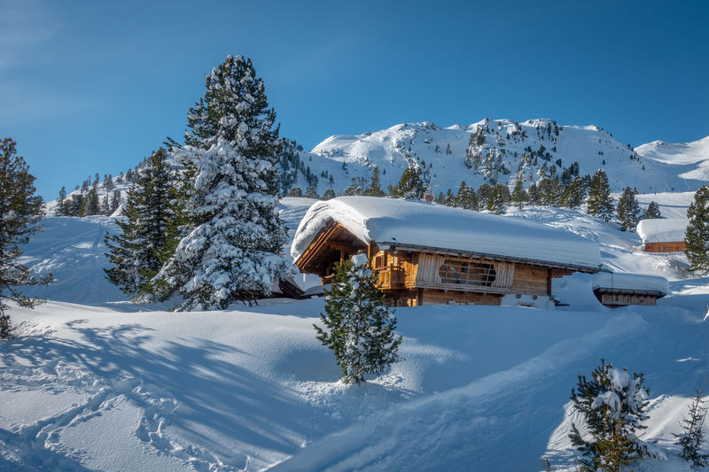 Winter Snow Cold Temperature Architecture Built Structure Beauty In Nature Nature Tree Building Exterior Scenics - Nature Mountain Plant Sky White Color Building Tranquility Tranquil Scene House No People Outdoors Snowcapped Mountain