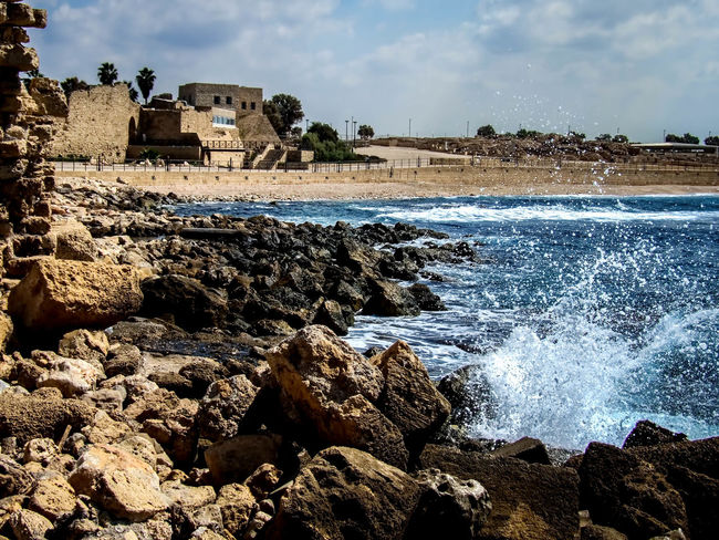 Caesarea's Antiquities Park Ancient, Antique, Archeology, Architecture, Art, Asia, Background, Beach, Beauty, Bible, Blue, Brick, Bright, Building, Caesarea, Calm, City, Clouds, Coast, Coastline, Construction, Culture, Harbor, History, Holy, Israel, Judea, Landmark, Landscape, Lines Architecture Beauty In Nature Built Structure Caesarea, Israel, Keysarya, Palestine, Arab, Jew, Israeli, Palestinian Caesarea's Antiquities Park Cloud Cloud - Sky Cloudy Coastline Day Fishing Harbor King Herod, Augustus Caesar, Caesar Nature Outdoors Rock Rock - Object Rock Formation Scenics Sea Shore Sky Travel Destinations Water Wave