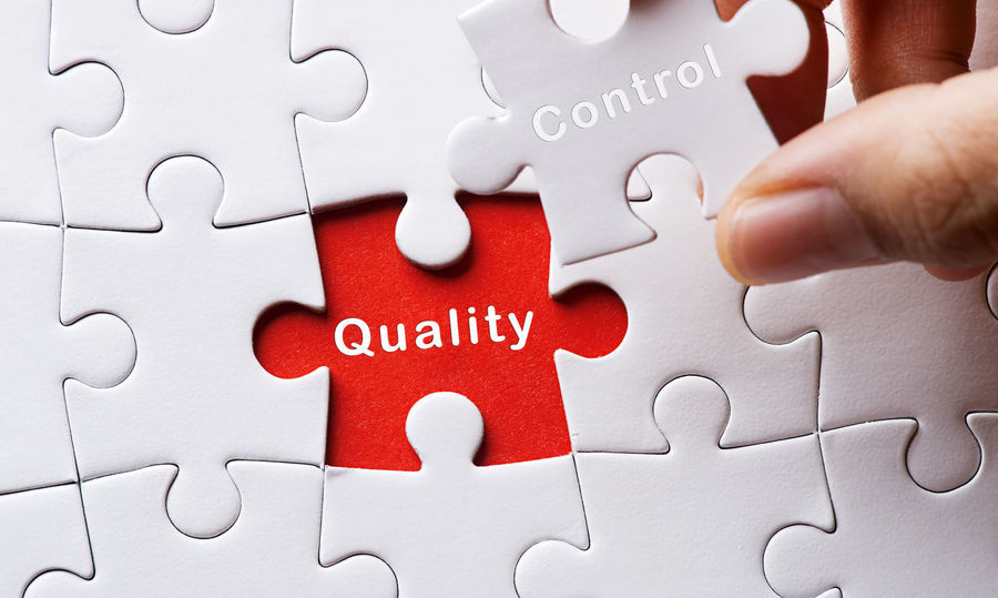 Quality Control Concept Improvement Relationship Business Concept Business Strategy Close-up Communication Connection Day Expertise Human Hand Jigsaw Piece Jigsaw Puzzle Leisure Games Optimization People Puzzle  Quality Check Quality Control Red Solution Strategy Teamwork Text White Background