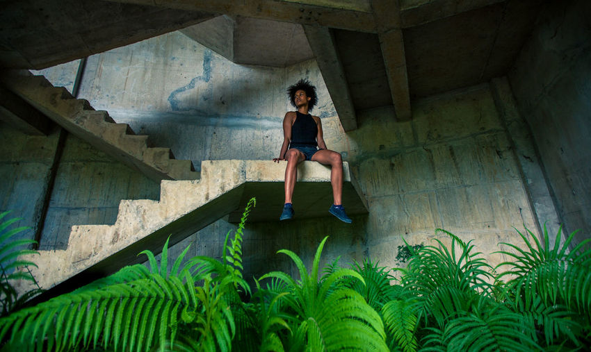 Jungle taking over! Stairs Steps Abandoned Architectural Column Architecture Beautiful Woman Built Structure Casual Clothing Concrete Front View Full Length Indoors  Jungle Lifestyles Looking At Camera One Person Portrait Real People Sitting Staircase Young Adult EyeEmNewHere Stories From The City Inner Power Visual Creativity The Architect - 2018 EyeEm Awards The Street Photographer - 2018 EyeEm Awards #urbanana: The Urban Playground Summer In The City A New Perspective On Life 17.62°