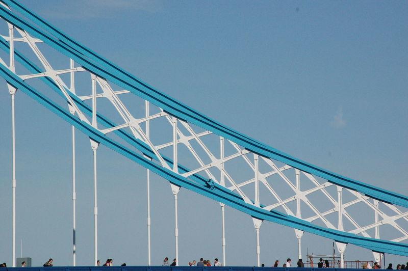 People On Tower Bridge Against Clear Blue Sky