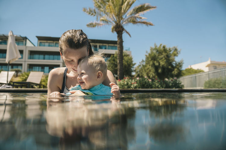Portrait of mother and daughter in swimming pool