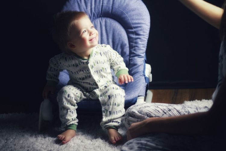 Full length of cute baby on bed