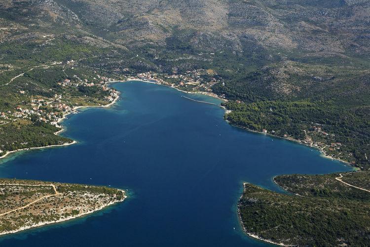 High angle view of sea and mountains