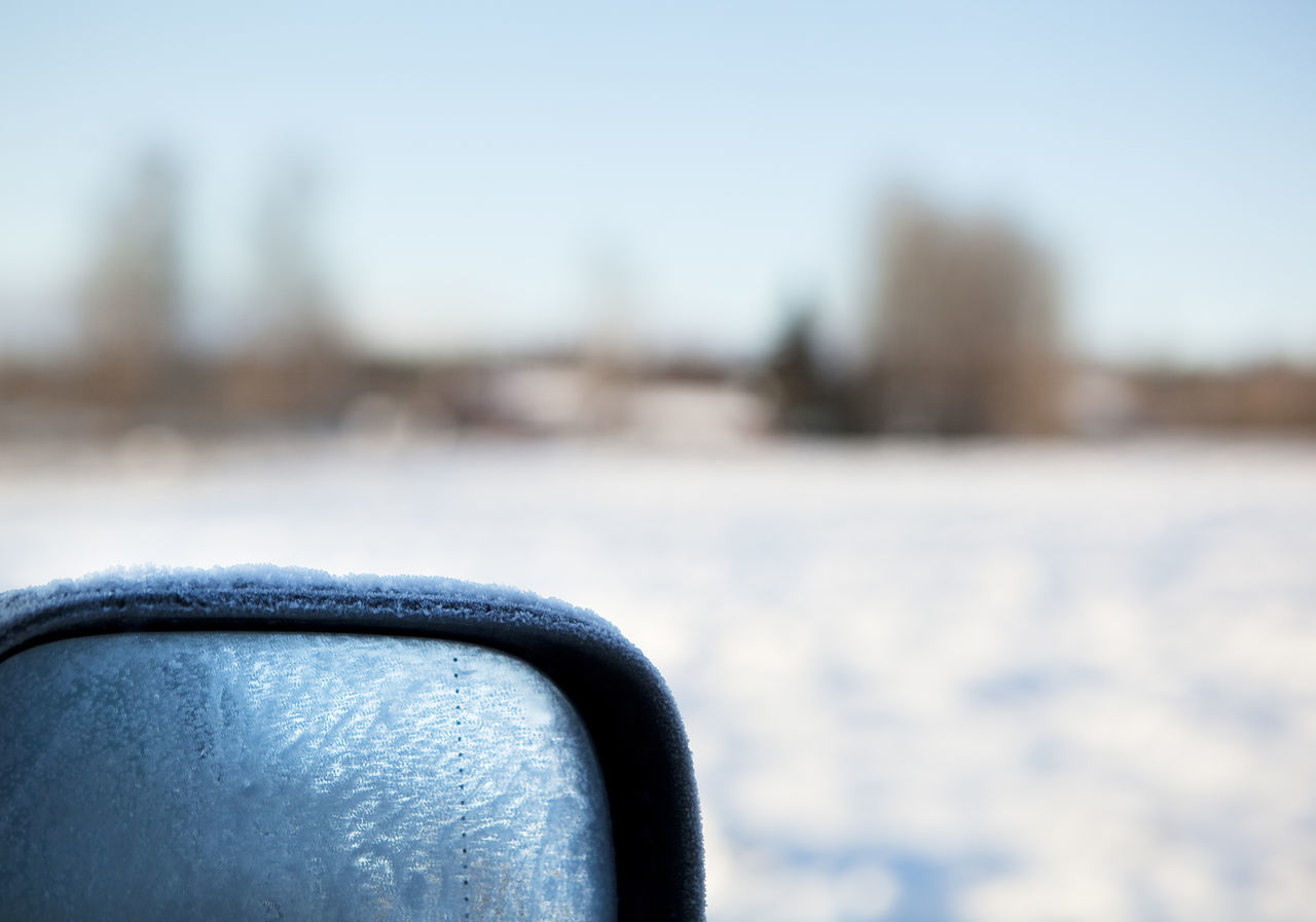 day, focus on foreground, nature, close-up, water, transportation, outdoors, no people, sky, selective focus, mode of transportation, winter, seat, river, land vehicle, travel, snow, blue