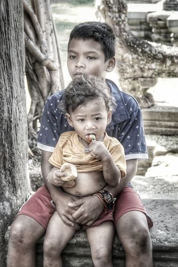 Eyes of Cambodia Siem Reap Cambodia EyeEm Best Shots EyeEmNewHere EyeEm Selects EyeEm Gallery Black And White Childhood Child Togetherness Sitting Happiness Bonding Males  Portrait Care Smiling Jungle Gym Babyhood Toddler  Baby Clothing Pacifier Baby Carriage Baby Boys Outdoor Play Equipment Monkey Bars Seesaw One Baby Boy Only Slide - Play Equipment Babies Only