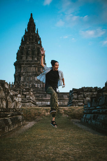 🙋 Travel Destinations Traveling Holiday Jump Folk Nature Temple Prambanan EyeEm Nature Lover EyeEm Indonesia The Great Outdoors - 2018 EyeEm Awards Man The Traveler - 2018 EyeEm Awards Full Length Place Of Worship Religion City Sky Architecture Historic Castle Ancient Civilization Pagoda Ancient Egyptian Culture Visiting