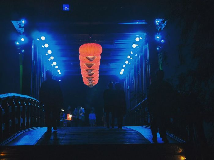 Chinese pedestrian bridge Pedestrian Bridge Night Walk Beautiful Light Beautiful Lighting And Decoration Beautiful Lights Chinese Decorations Illuminated Neon Neon Colored Chinese Lantern