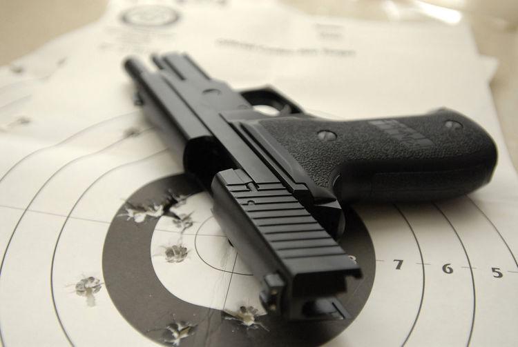 Close-up of gun on sports target