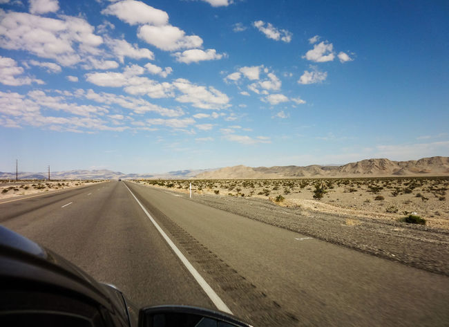 Desert Road Desert Car Car Point Of View Cloud - Sky Day Endless Road Land Vehicle Landscape Mode Of Transport Nature No People Outdoors Road Scenics Sky The Way Forward Transportation Windshield Roadtrip Road To Nowhere Lost In The Landscape Been There. Done That. An Eye For Travel California Dreamin Summer Exploratorium Summer Road Tripping My Best Travel Photo