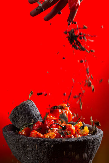 Spicy Spicy Food Animal Themes Chilli Close-up Day Food Habanero Peppers Hot Chillies Mid-air Molcajete No People Red Sauce Studio Shot